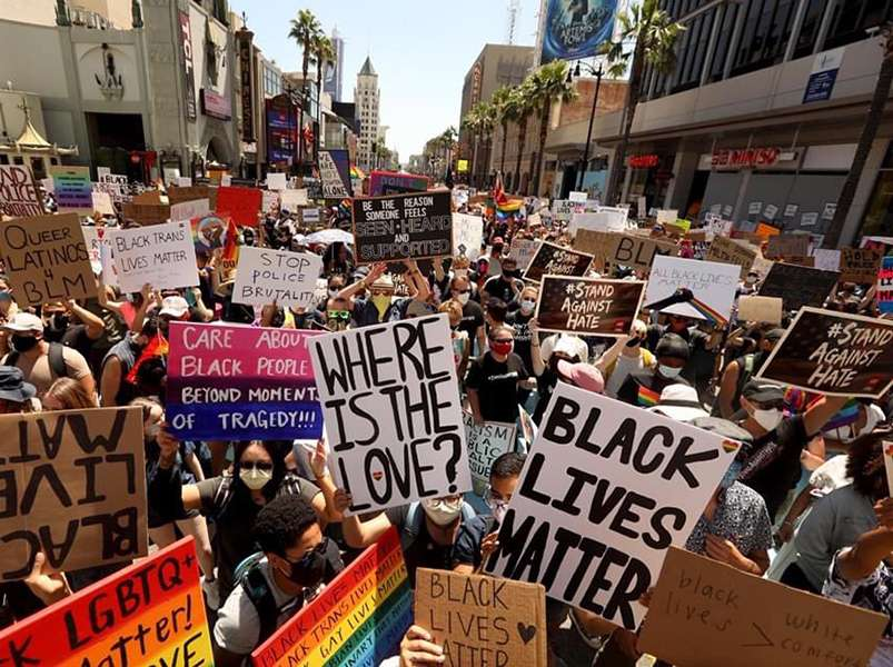 Thousands across US march for black and trans lives as Trump erases trans rights
