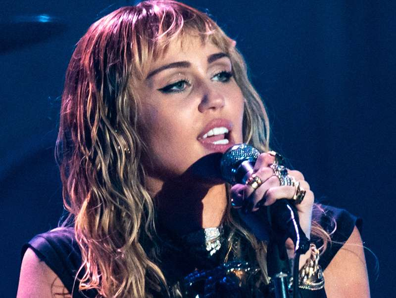 Miley Cyrus says her first sexual experience was a threesome with two girls