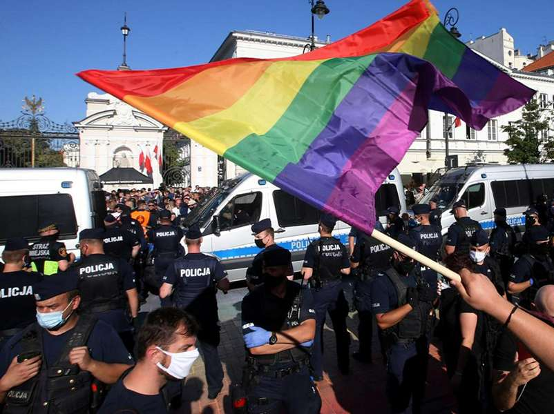 Polish nationalists burn rainbow flags as LGBT+ campaigners lead counter demo